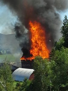 Denise Robillard took this photo as her beloved barn burned on August 23.