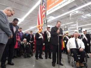 Pastor Larry Wall providing opening prayer. The Knights of Columbus provided the color guard.