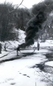 Stopping the flow of oil was one thing, cleaning up the mess was another. Oil company officials are seen in this photo attempting to burn the oil from an ice covered Black River.